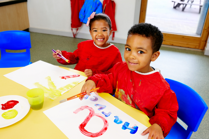 Preschool children doing craft activities at kindergarten